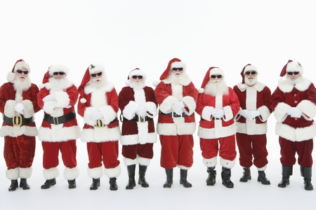 Group of men dressed as Santa Claus wearing sunglasses Stock Photo - 12735124