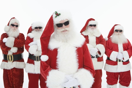 dressing up costume: Group of men dressed as Santa Claus wearing sunglasses