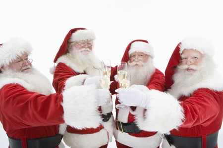 Group of men dressed as Santa Claus toasting champagne Stock Photo - 12735130