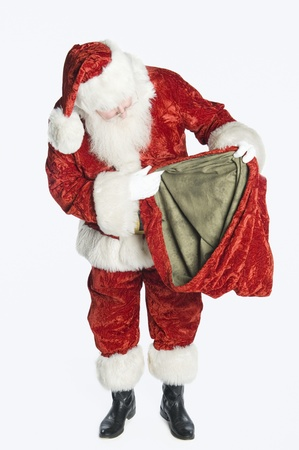 Santa Claus holding sack Stock Photo - 12735171