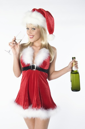 Mrs Claus with bottle of champagne Stock Photo - 12735154