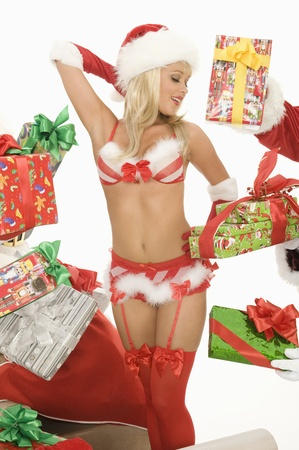 santa lingerie: Mrs Claus in underwear surrounded by gifts