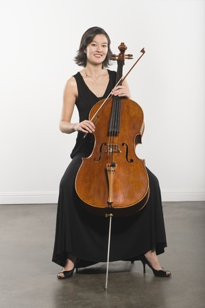 Full length portrait of cello player Stock Photo - 12735161