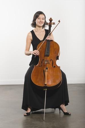 cellist: Full length portrait of cello player