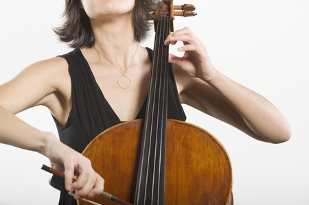 Mid section of female cellist Stock Photo - 12735135