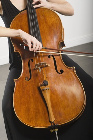 Mid section of woman bowing a cello Stock Photo - 12735136