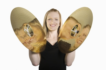 cymbals: Young woman plays the cymbals LANG_EVOIMAGES