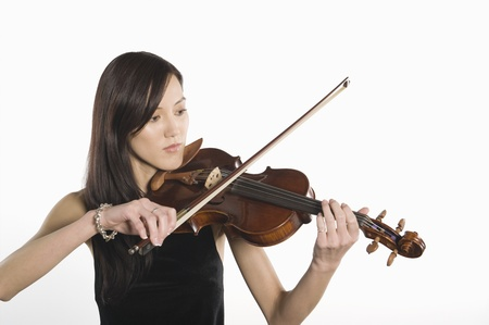 Young Asian woman plays the violin Stock Photo - 12735177