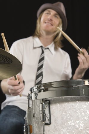 Young man plays the drums Stock Photo - 12735193