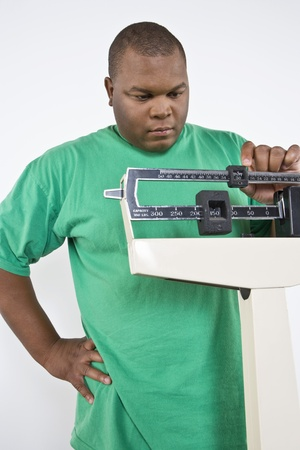 body concern: Man using weight scales