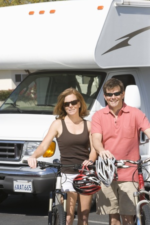 recreational vehicle: Mature couple on cycling holiday with recreational vehicle