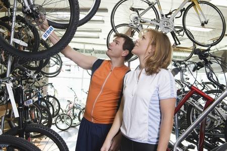Mature couple choose a new bike Stock Photo - 12735259