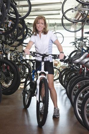 Female cyclist chosses a new bike Stock Photo - 12735261