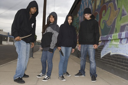 Group of young people posing with knives Stock Photo - 12735326