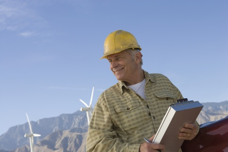 Senior man working at wind farm Stock Photo - 12735323