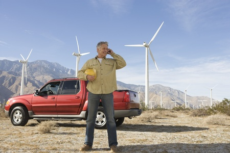 Senior man working at wind farm Stock Photo - 12735325