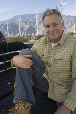Senior man near wind farm portrait Stock Photo - 12735328