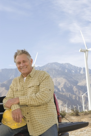 Senior man working at wind farm Stock Photo - 12735320