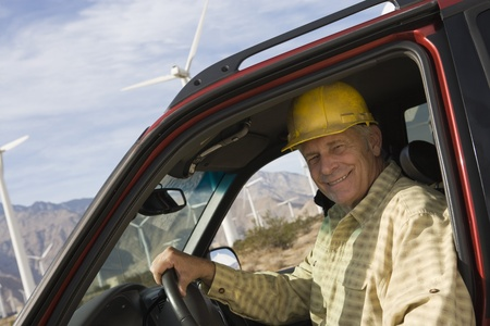 Senior man in truck at wind farm Stock Photo - 12735331