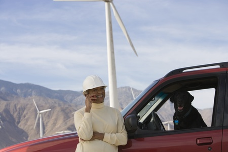 Mature woman by truck at wind farm Stock Photo - 12737831