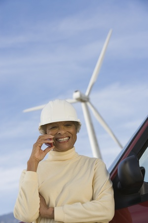 Mature woman by truck at wind farm Stock Photo - 12737832