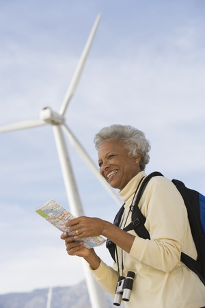 Mature woman with map by wind farm Stock Photo - 12737833