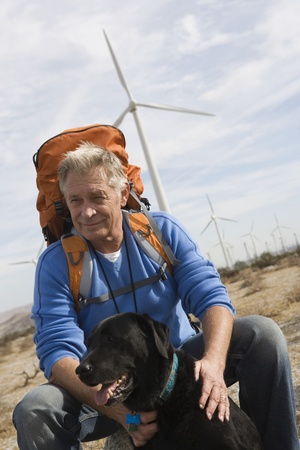 Senior man with backpack near wind farm Stock Photo - 12737838