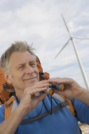 Senior man with backpack near wind farm Stock Photo - 12737839