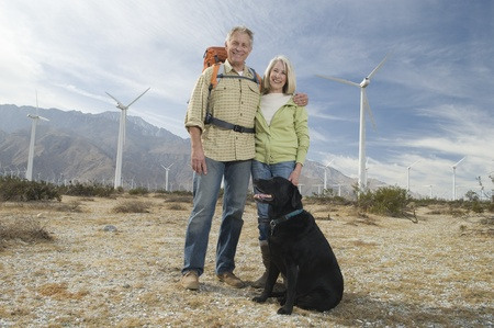 Senior couple with dog near wind farm Stock Photo - 12737847