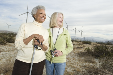 Women hiking near wind farm Stock Photo - 12737855