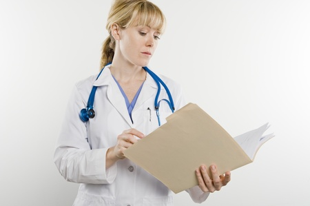 Doctor with medical file Stock Photo - 12737895