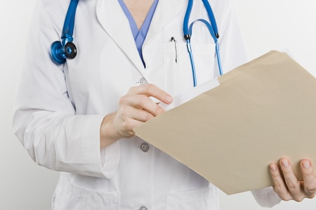 Doctor with medical file mid section Stock Photo - 12737896