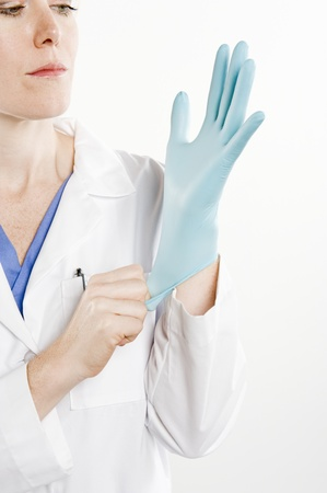 Doctor with rubber glove Stock Photo - 12737898
