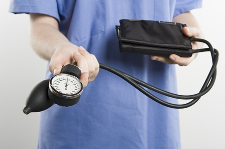 Surgeon with blood pressure gauge mid section Stock Photo - 12737905