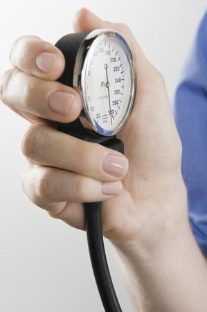 blood pressure gauge: Surgeon with blood pressure gauge close up