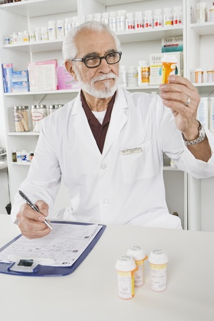 Male pharmactist working in pharmacy Stock Photo - 12737961