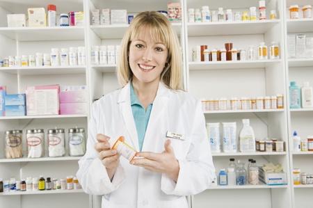pharmacy: Female pharmactist portrait LANG_EVOIMAGES