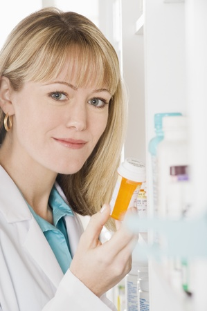 Female pharmactist working in pharmacy Stock Photo - 12737966