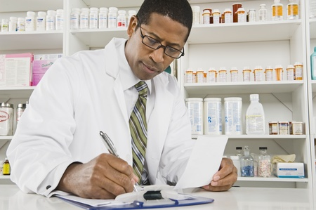 Male pharmactist working in pharmacy Stock Photo - 12737968
