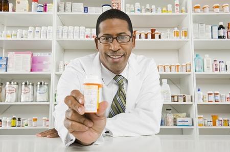 Male pharmactist working in pharmacy Stock Photo - 12737973