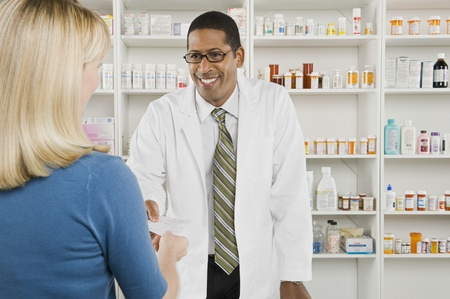 Woman picking up prescription drugs at pharmacy Stock Photo - 12737977