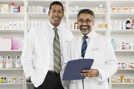 greying: Two male pharmacists portrait LANG_EVOIMAGES