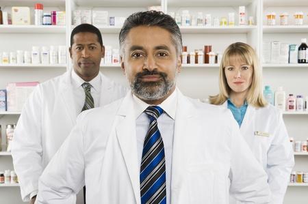 three shelves: Three pharmacists portrait