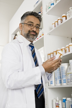 Male pharmactist working in pharmacy Stock Photo - 12737985