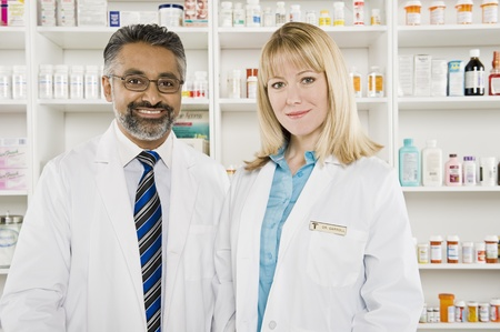 greying: Two pharmacists portrait LANG_EVOIMAGES