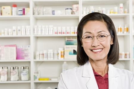 chemist: Female pharmactist portrait LANG_EVOIMAGES