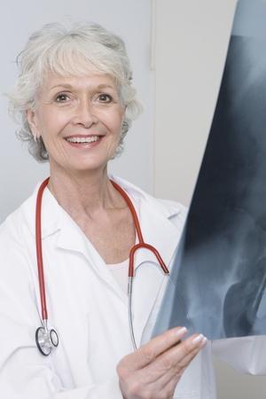 Senior medical practitioner holding xray Stock Photo - 12738031