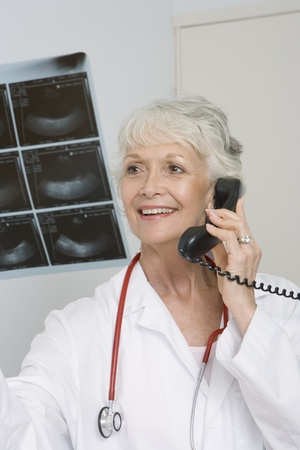 Senior medical practitioner holding xray Stock Photo - 12738032
