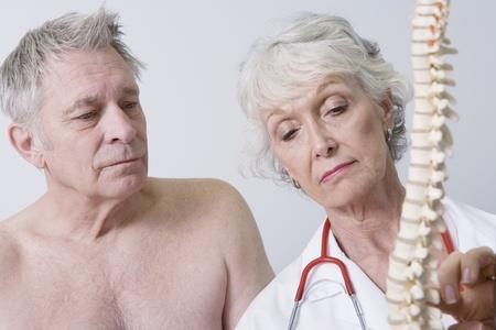 anatomical model: Senior medical practitioner explains anatomical model LANG_EVOIMAGES