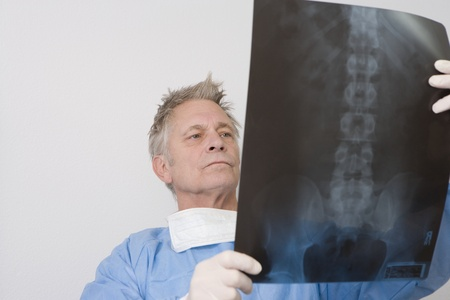 Senior medical practitioner stands with xray Stock Photo - 12738045
